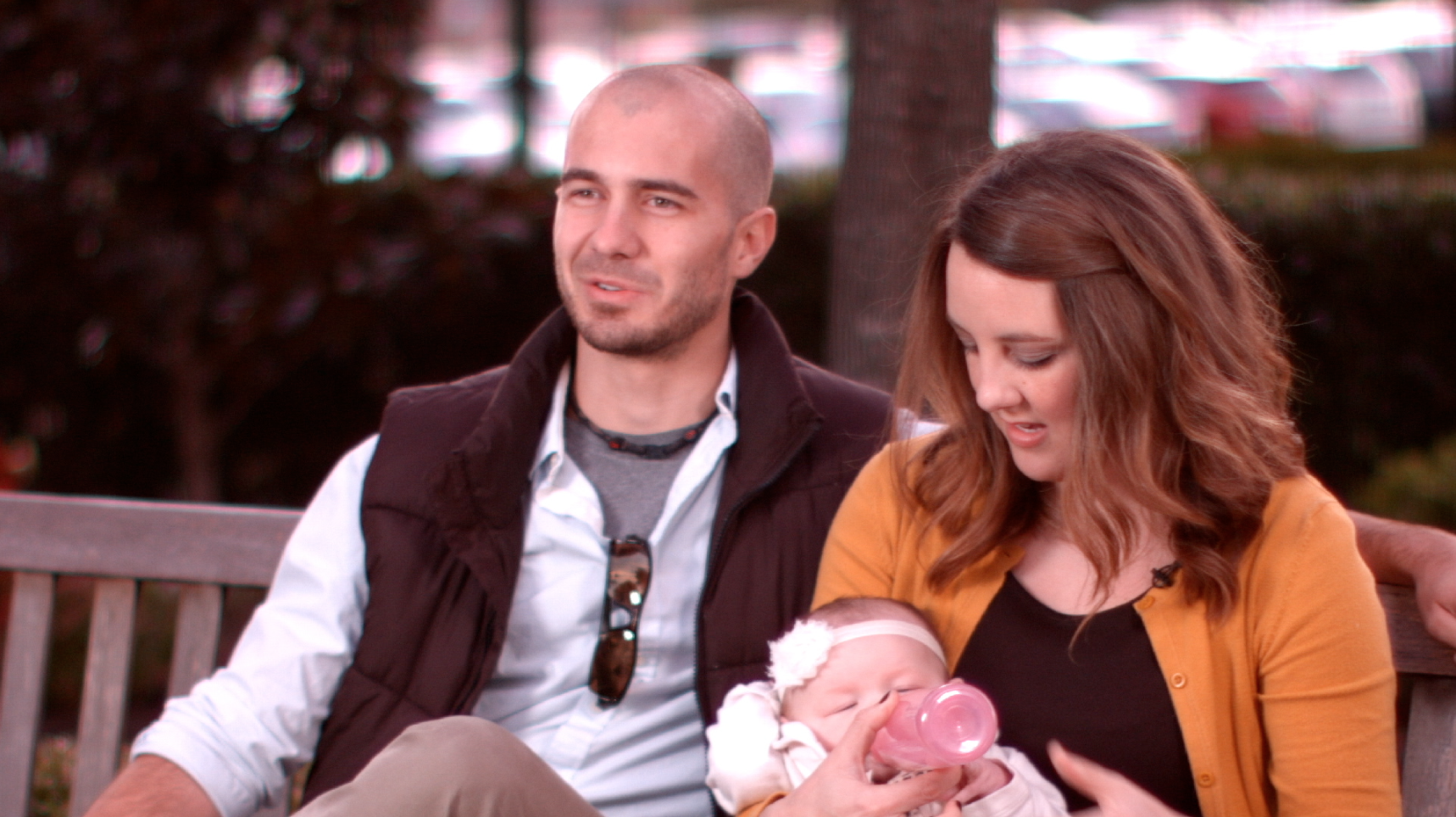 A Couple looking at their baby in a screenshot of the Baptist Health Corporation Video produced by Light Productions